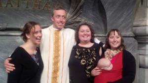 Me, my three sisters, and my oldest nephew immediately following my ordination