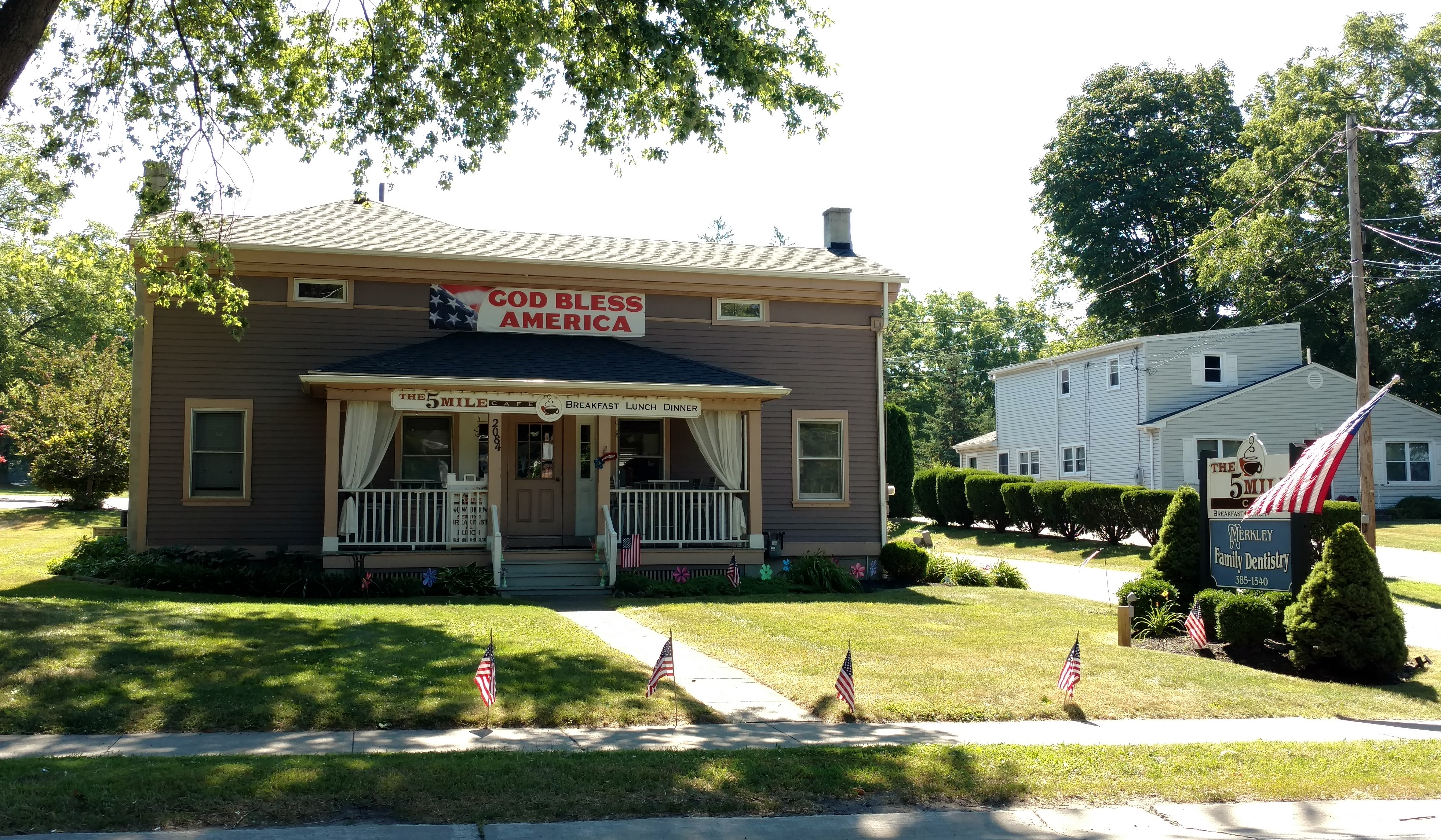 Five Mile Cafe in Penfield, NY, displaying flags and banner