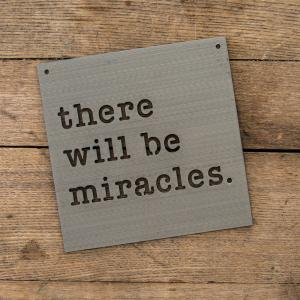 "A sign says, ""There will be miracles."""