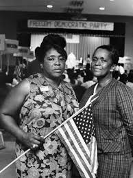 Fannie Lou Hamer,, carrying flag, leads Freedom Democratic Party delegation.