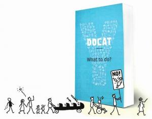 The book, DOCAT, stands next to a protest parade of stick figures.