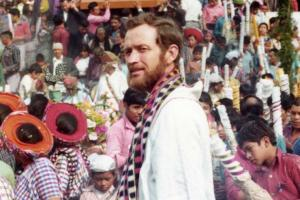 Fr. Rother pictured with a festive crowd of Guatemalan people.