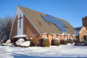 A church with solar panels on the roof.