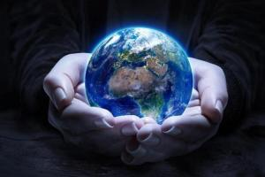 Hands holding a globe of the precious earth.