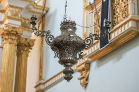 A sanctuary lamp occupies a prominent position in this church building.