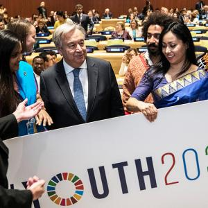 The Secretary General appears with youth activists.