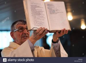 The Book of the Gospels is held high in the Liturgy of the Word.