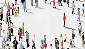 One apparently lonely person stands out from a crowd of people, each engaged with something or someone else.