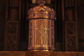 A gold tabernacle in its place in church.