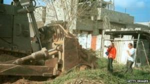 A bulldozer, Rachel Corrie, and a Palestinian home.