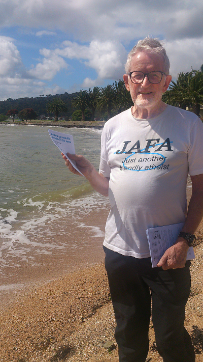 David Hines, a Christian who also calls himself a friendly atheist, is seen here handing out anti-missionary pamphlets at the bicentennial of the first Christian service in the Bay of Islands, New Zealand. He was escorted off the beach by the local Maori chief's security guard. (JAFA is a local acronym for Just Another Fucking Aucklander).