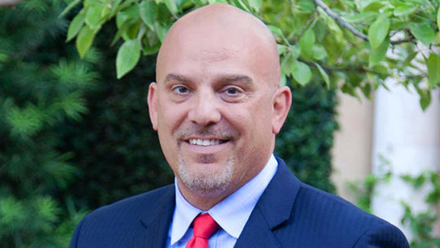 Dr. Kent Paredes Scribner