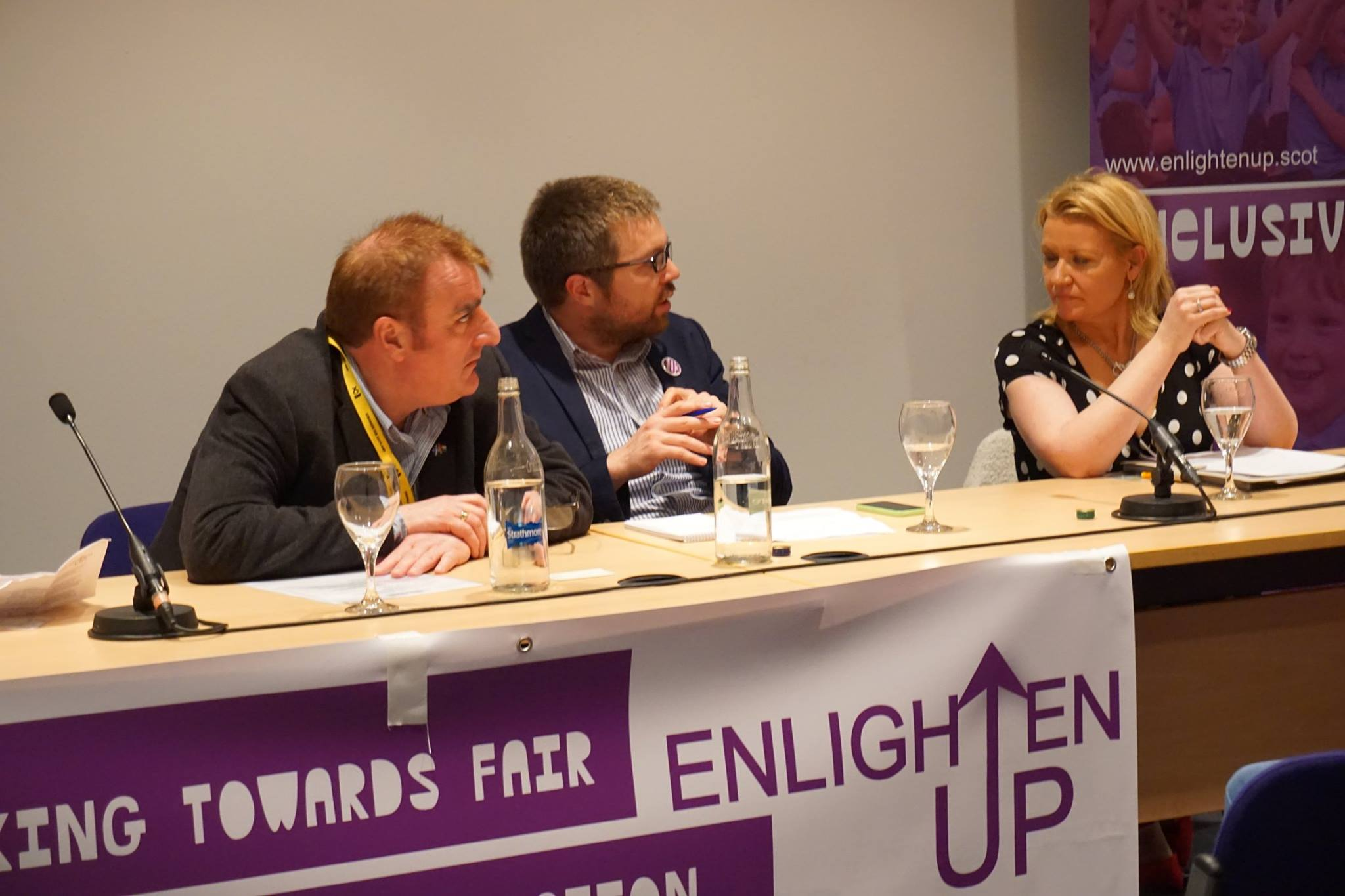 Tommy Sheppard (far left) moderates the panel discussion