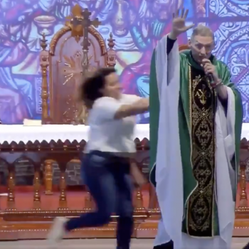 A Woman Assaulted a Brazilian Priest While He Spoke to an Audience of Thousands