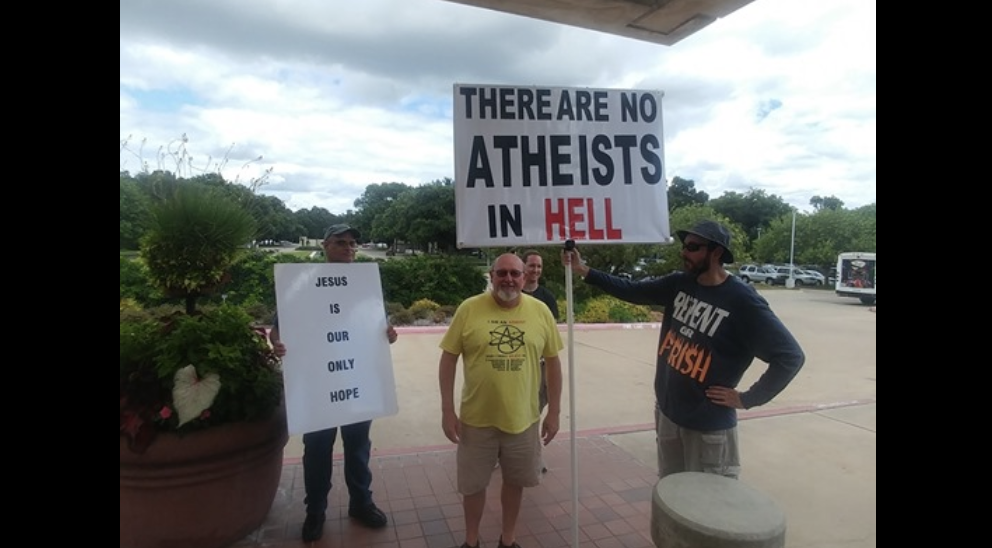 This Protester Outside a TX Atheist Group's Event Needs to Rethink His Sign
