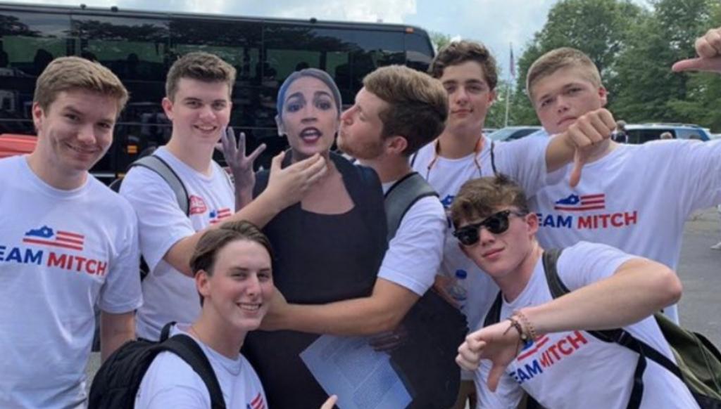 "The ""Team Mitch"" Boys Choking a Cutout of AOC Attend a"
